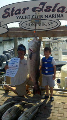 Anthony Vaccaro 50.7lb Striped Bass with Anthony Jr.