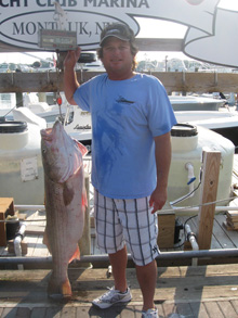 Troy Wilson 1st mate on the Marlena with his 50.1lb Striped Bass caught on June 30 using live eels.